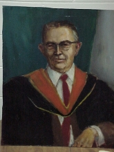 PORTRAIT OF MAN IN ACADEMIC ROBE